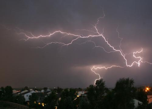 large bolt of lightning across night sky