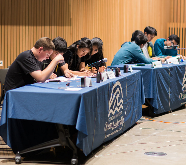 students competing at tables