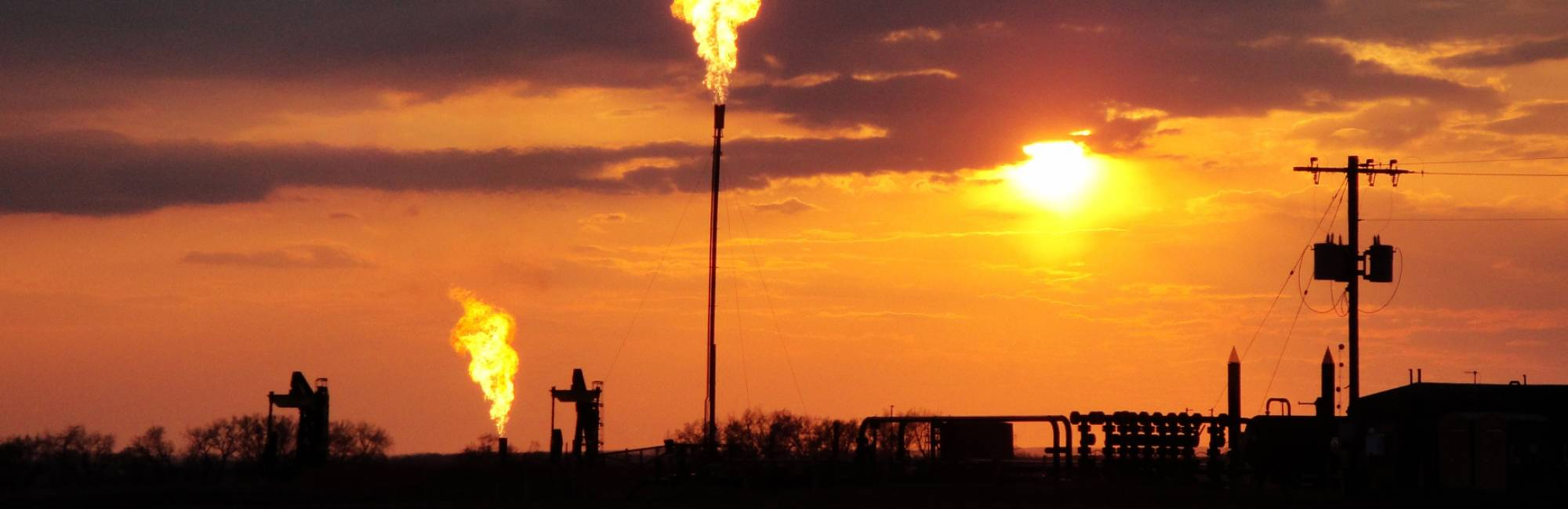 Methane is flared from a Bakken Field well site in North Dakota in this 2014 photo.