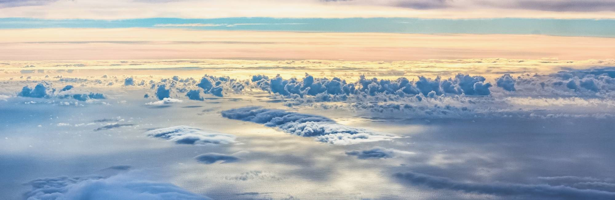 View of clouds capturing the morning light taken from the NASA DC-8 shortly after it took off from the Azores en route to Bangor, Maine on October 23, 2017.