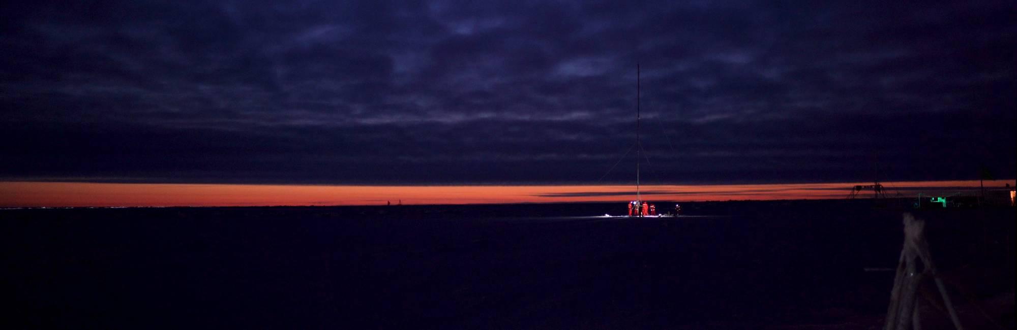 forboding purple sky over dark ice