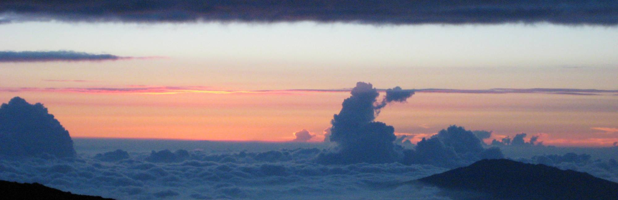 view of sky and clouds from NOAA's Mauna Loa Atmospheric Baseline Observatory, which sits at 11,140 feet, on top of Hawaii's tallest volcano.