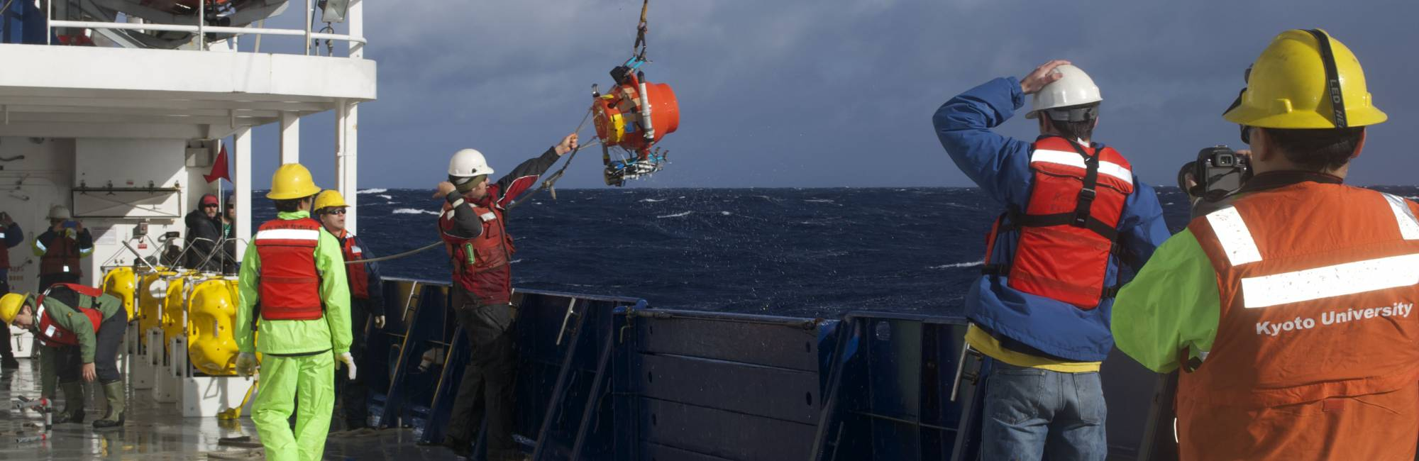 Scientists on the R/V Roger Revelle recover a Tohoku University seafloor absolute pressure gauge after one year on the seafloor offshore Gisborne, New Zealand. Photo credit: Elizabeth Brenner, Scripps Institution of Oceanography