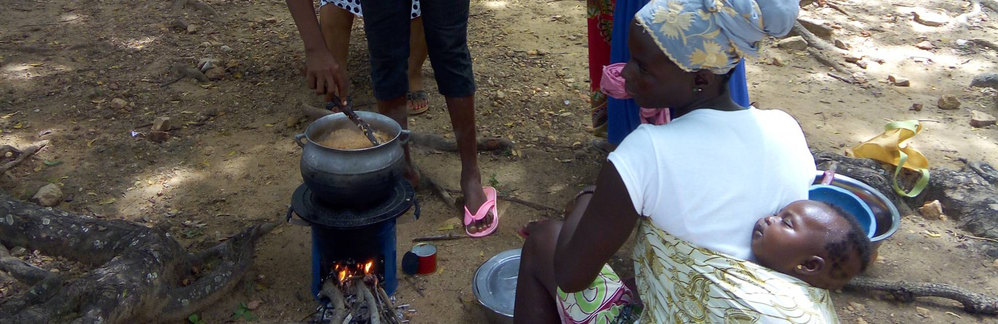 Women in Northern Ghana test out an improved wood stove during a focus group session (October 2016)
