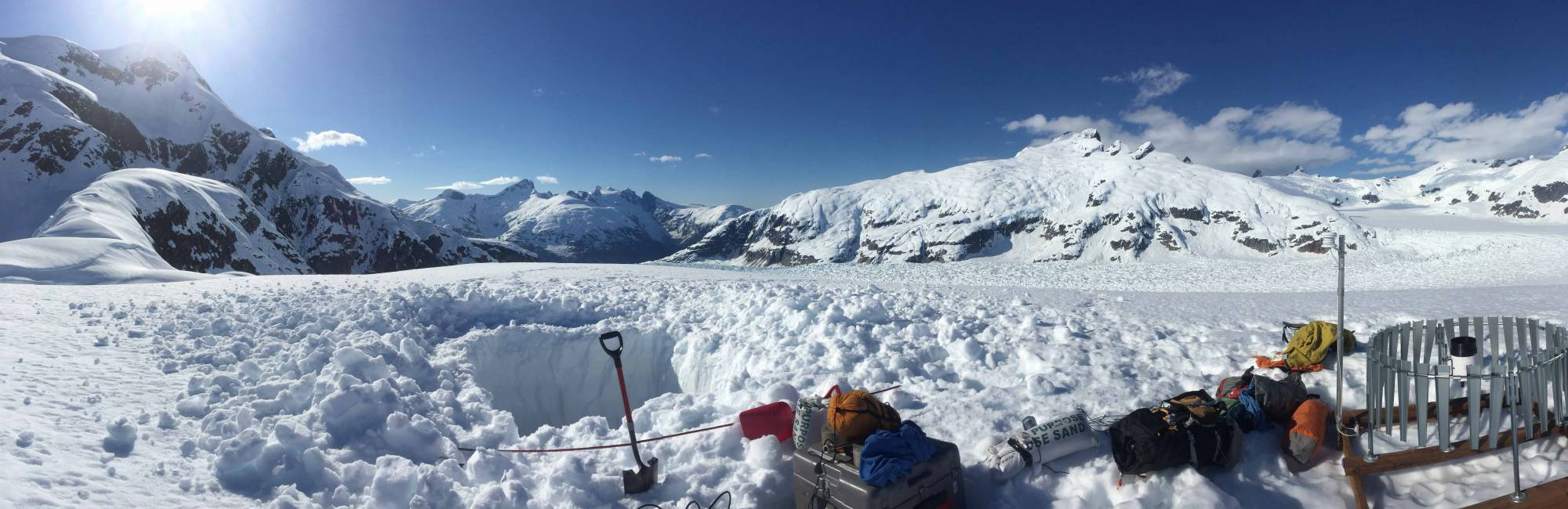 instruments in snow at base of alaskan mountain and glacier