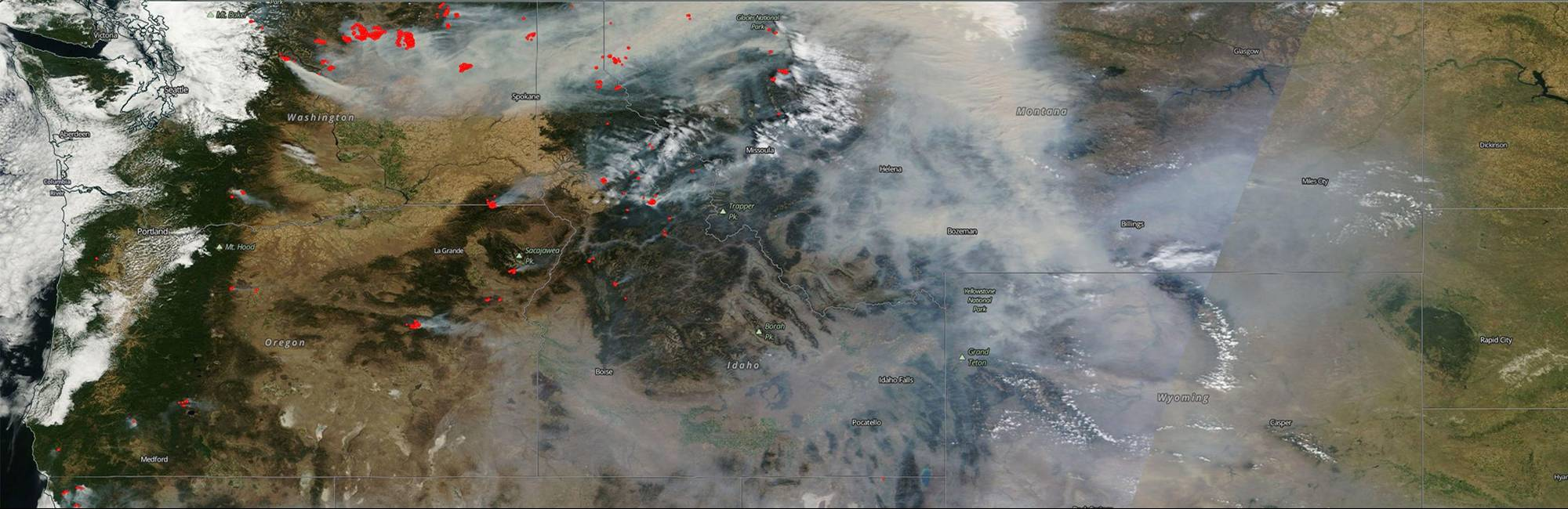 Satellite image of fires in the U.S. Pacific Northwest with smoke spanning the Western United States.