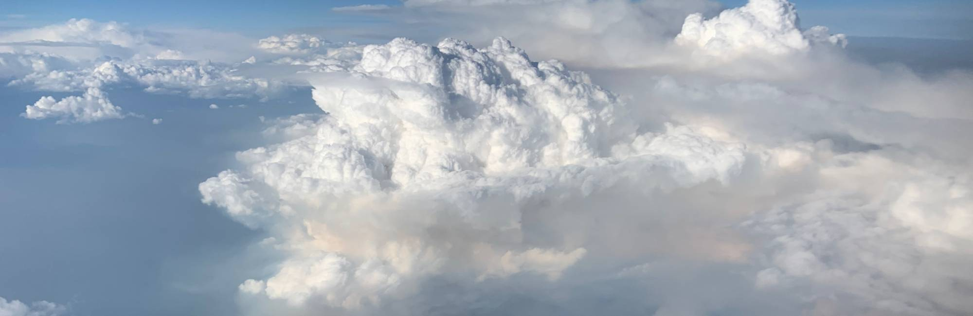 Photo of a pyrocumulonimbus cloud (generated by a wildfire) injecting smoke high into the atmosphere.