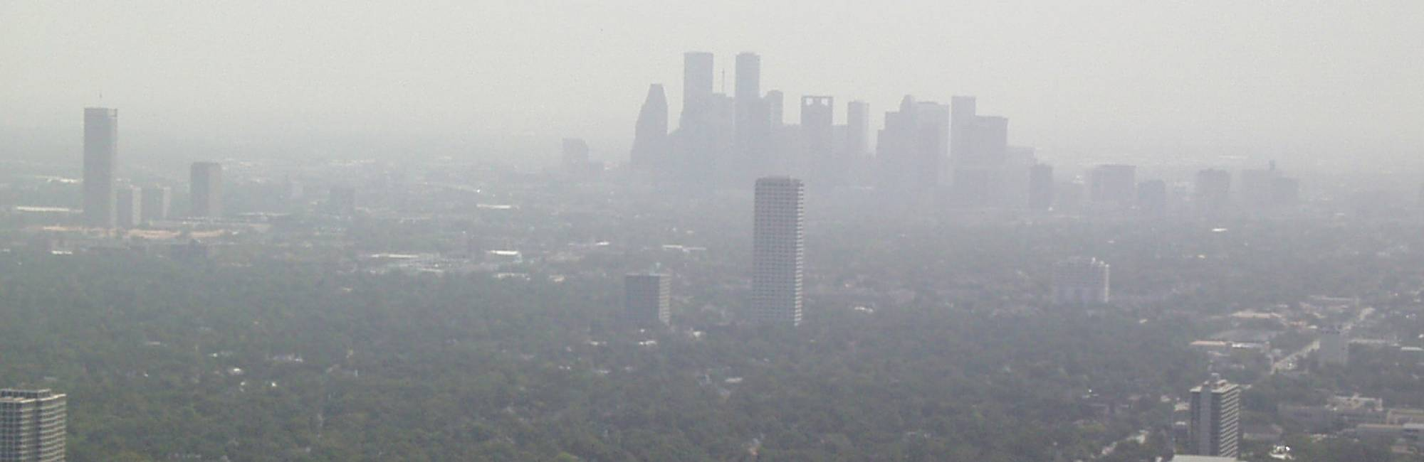 Photo of polluted downtown Houston skyline.