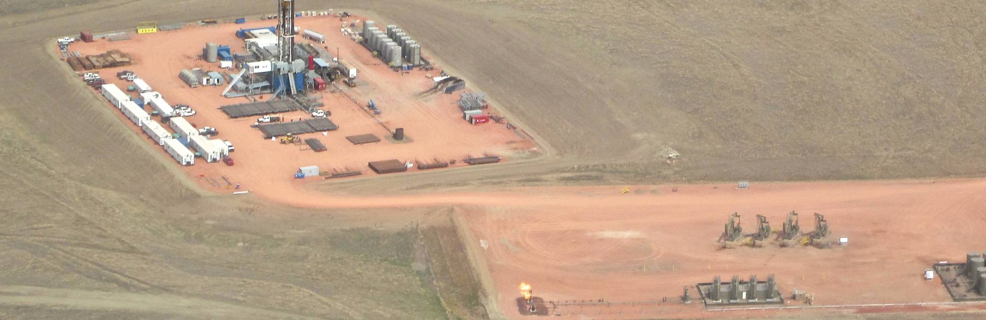 drill rig and tons of equipment on the ground in north dakota