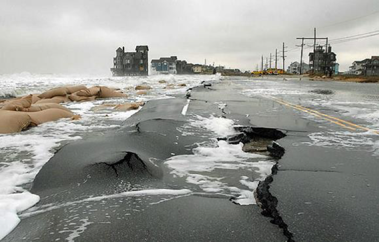 cracked, washed out road covered in water