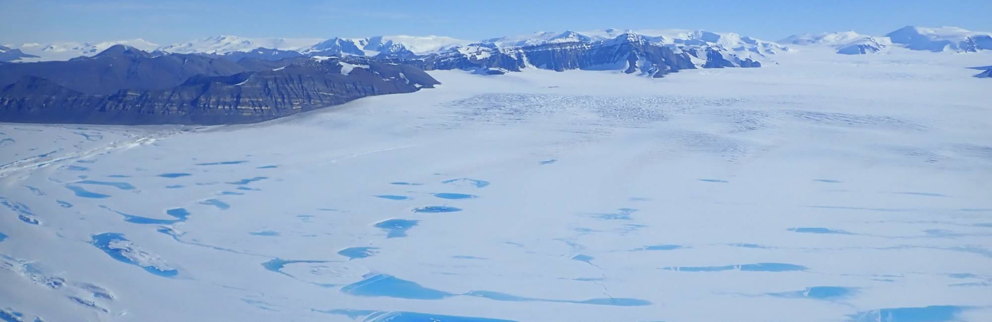 Photo of meltwater lakes on Antarctica's George VI Ice Shelf.