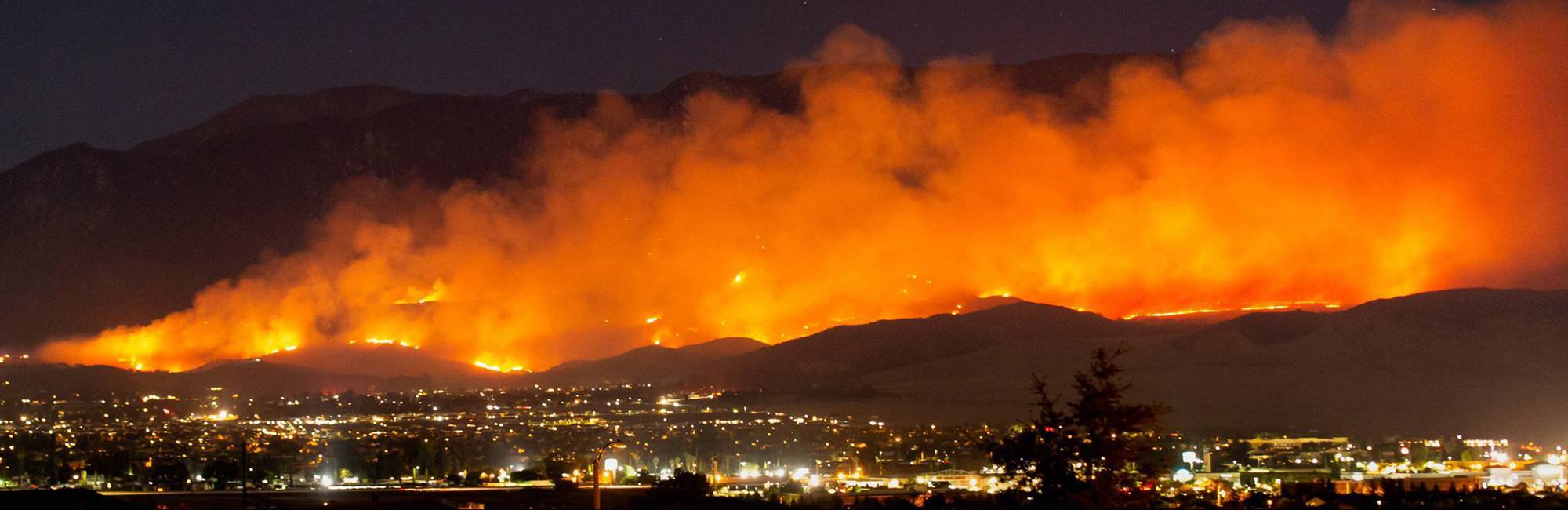 Photo of the Apple Fire burning in the foothills above Beaumont, California in July, 2020.