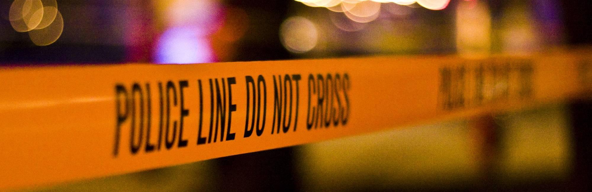 police line tape with lights in dark scene
