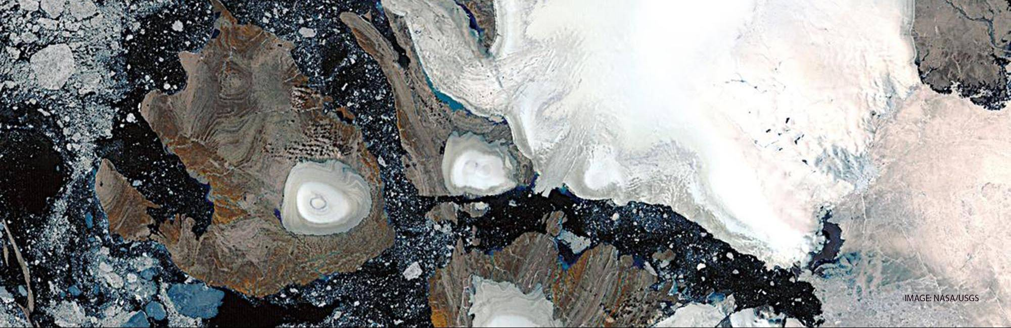 Landsat image of ice caps in northern Savernaya Zemlya, Russian Arctic Islands (80 degrees N.). The scene shows zones of melting on the ice caps. The largest ice cap is about 80 km across. Image courtesy of Julian Dowdeswell, Scott Polar Research Institute, Cambridge, UK.