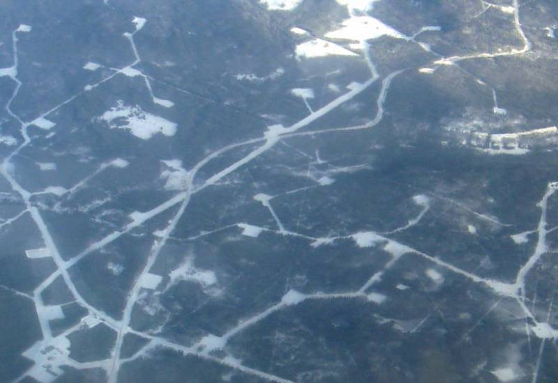 Aerial view of oil leases in the Pembina oil field in Alberta, Canada. / Wikimedia Commons