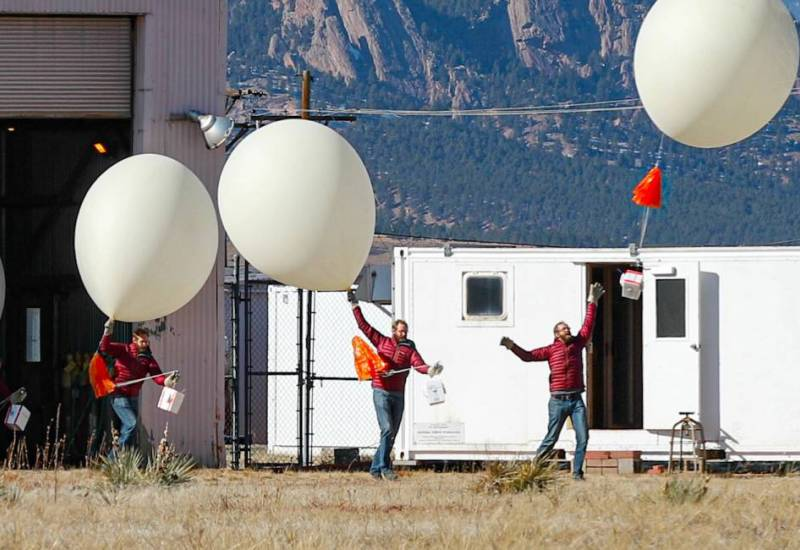 Photographic time series capturing the launch of an ozonesonde balloon from Boulder's Marshall Mesa field site.