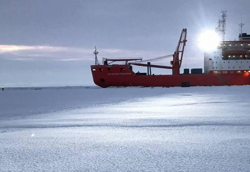 Icebreaker on frozen ocean