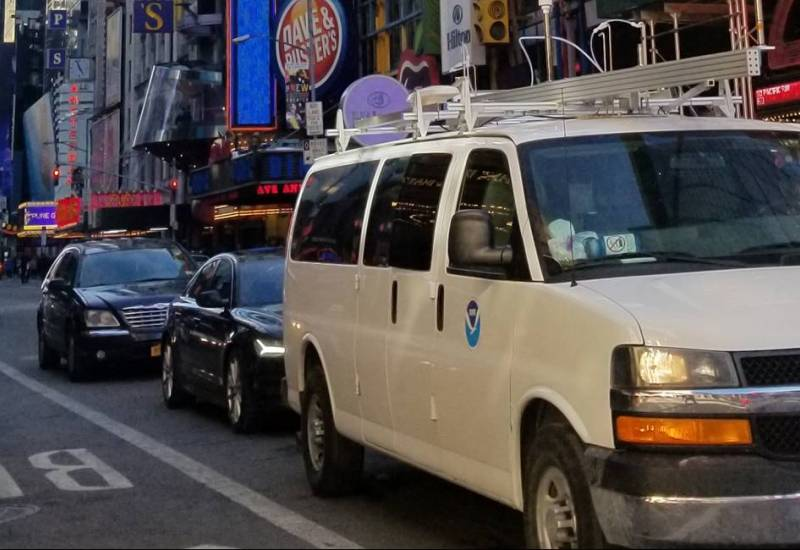 Photo of an instrumented NOAA van driving down a busy New York City street.