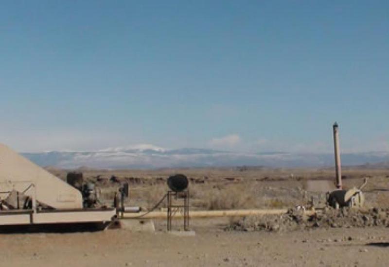 Oil well pad and atmospheric sampling van in Uintah County, Utah.
