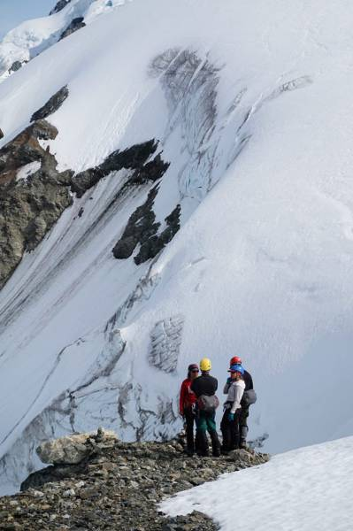 Alice works with small group leadership team to negotiate a plan to descend steep glacial pass_Gulkana Glacier_Alaska Range_photo credit Christian martin.jpg